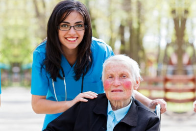 nurse with her patient smiling